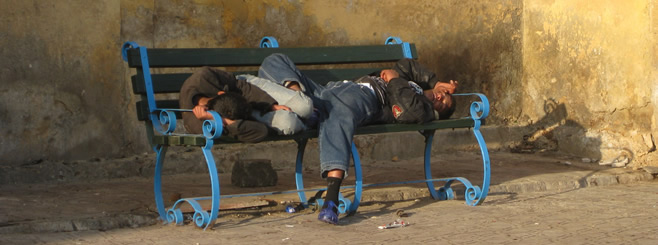 Boys sleeping on bench